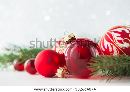 Red xmas ornaments and xmas tree on glitter holiday background. Merry christmas card. Winter holidays. Xmas theme. Happy New Year. - stock photo