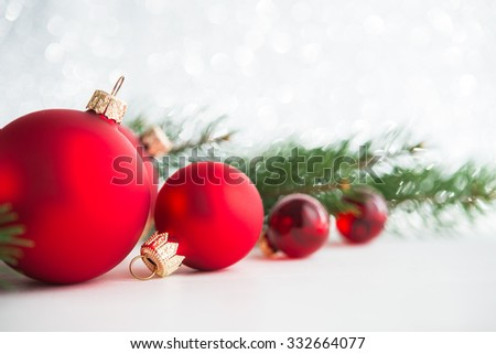 Red xmas ornaments on glitter holiday background. Merry christmas card. Winter theme. Happy New Year.