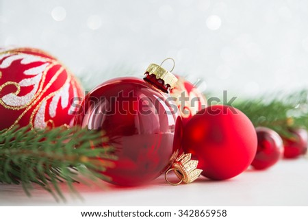 Red xmas ornaments on glitter holiday background. Merry christmas card. Winter theme. Happy New Year. - stock photo
