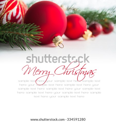 Red xmas ornaments on white background. Merry christmas card. Winter holidays theme. Happy New Year. Space for text. - stock photo