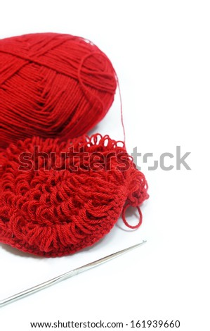 red yarn and crotchet hook isolated  - stock photo