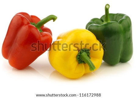 red,yellow and green bell peppers (capsicum) on a white background - stock photo