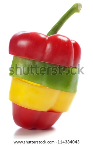 Red Yellow and Green peppers sliced and mixed up to look like one pepper on isolated white background