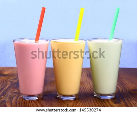 Red, yellow and green soft drink, milk shake, close up - stock photo