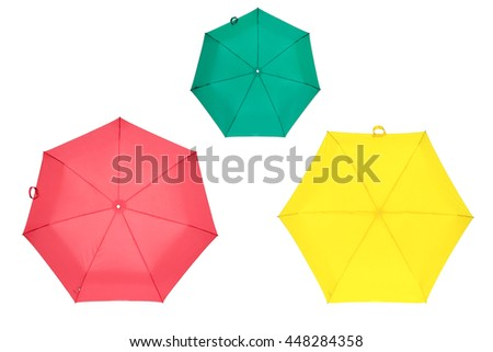 Red, yellow and green umbrellas - stock photo