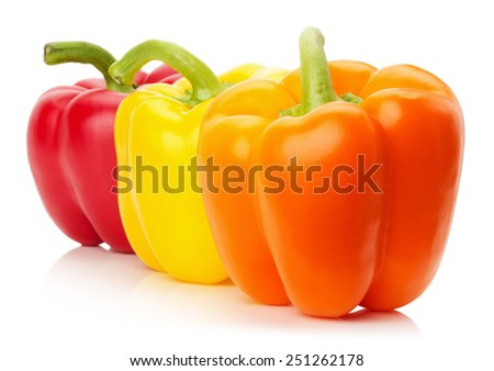 red, yellow and orange peppers isolated on the white background - stock photo