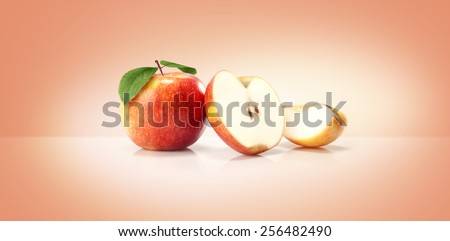 red yellow apples isolated on colored background - stock photo