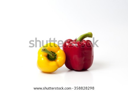 red yellow bell peppers (capsicum) on a white isolated  background - stock photo