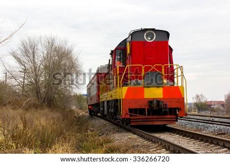 red-yellow locomotive train on the tracks - stock photo