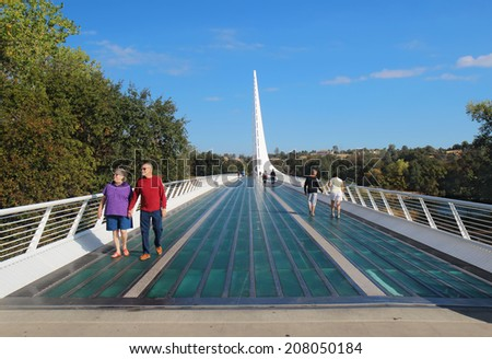 REDDING, CALIFORNIA - OCTOBER 8 2012: Sundial Bridge at Turtle Bay in Redding, California. This pedestrian and bicycle bridge over the Sacramento River, built in 2004, is an iconic symbol of Redding. - stock photo