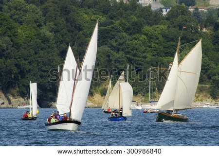 Redes Village, Galicia, Spain ; July 21, 2012 . Traditional sailing  boats racing regatta in Ares bay