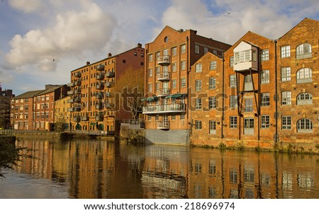 Redeveloped warehouses along the River Aire in Leeds, now fashionable flats - stock photo