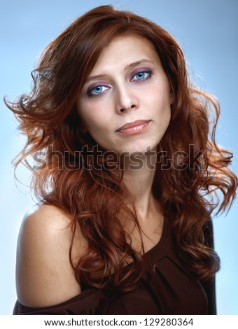 redhair beauty woman with blue eyes - stock photo
