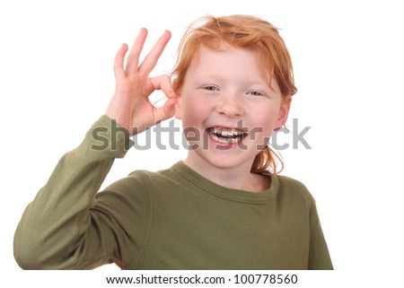 Redhaired girl showing ok sign - stock photo