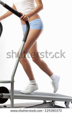 redhaired woman on a running simulator - stock photo
