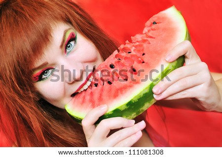 redhead bright girl enjoying sweet watermelon