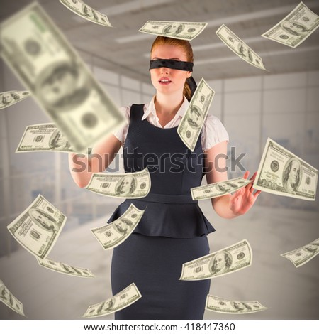Redhead businesswoman in a blindfold against modern room overlooking city - stock photo