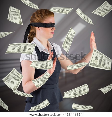 Redhead businesswoman in a blindfold against white room with floorboards - stock photo