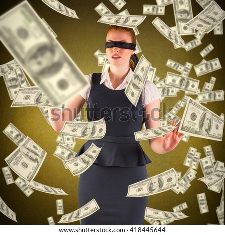 Redhead businesswoman in a blindfold against yellow background - stock photo