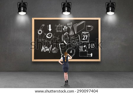 Redhead businesswoman scratching her head against blackboard with copy space - stock photo