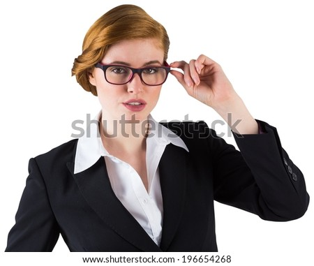 Redhead businesswoman touching her glasses on white background