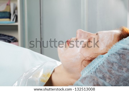Redhead caucasian woman waiting face massage eyes closed