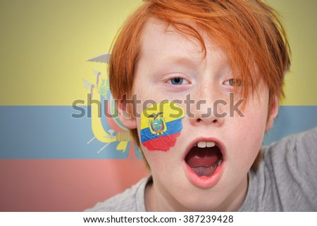 redhead fan boy with ecuadorian flag painted on his face.  - stock photo