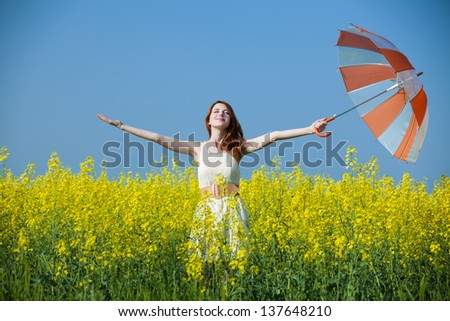 Redhead girl at field - stock photo