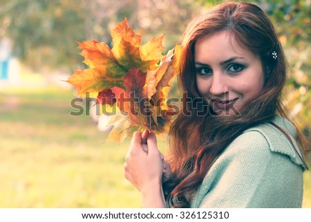 redhead girl Autumn leaves