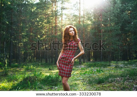 redhead girl in the forest - stock photo