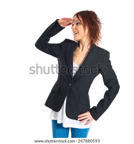 Redhead girl showing something over white background