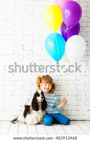 Redhead girl with a cocker spaniel