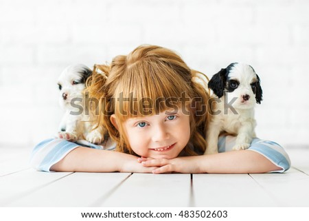 Redhead girl with a puppies cocker spaniel