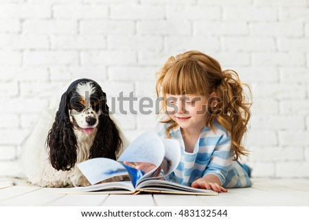 Redhead girl with a puppy cocker spaniel