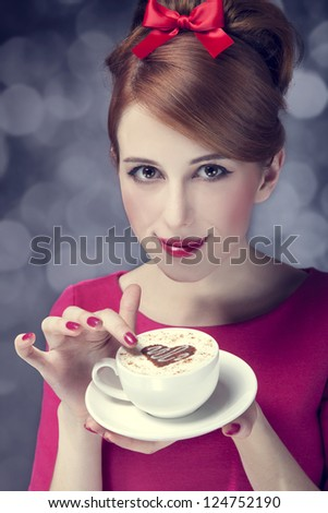 Redhead girl with coffee cup. St. Valentine's Day. - stock photo