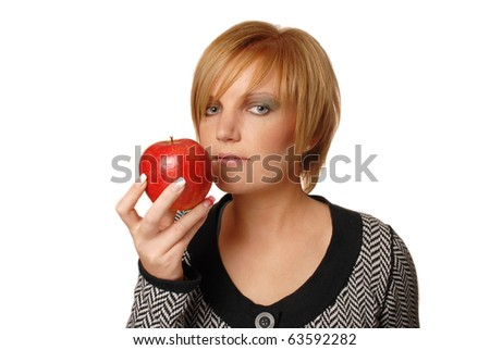 redhead girl with red apple, focus on apple