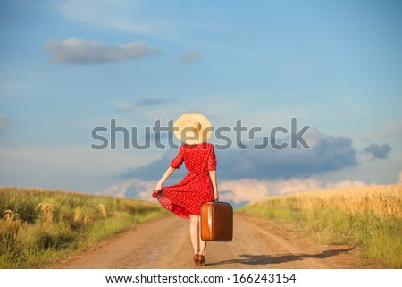 Redhead girl with suitcase at outdoor. - stock photo