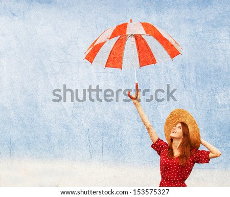Redhead girl with umbrella