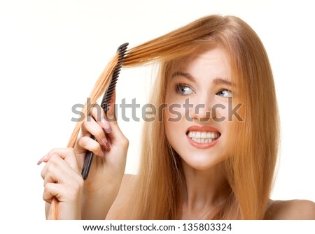 redhead girl with unruly hair - stock photo