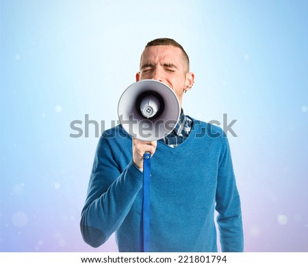 Redhead man shouting by megaphone over gloss background