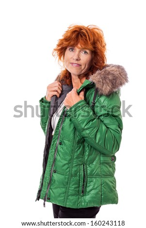 redhead smiling adult mature woman with geen warm jacket isolated on white