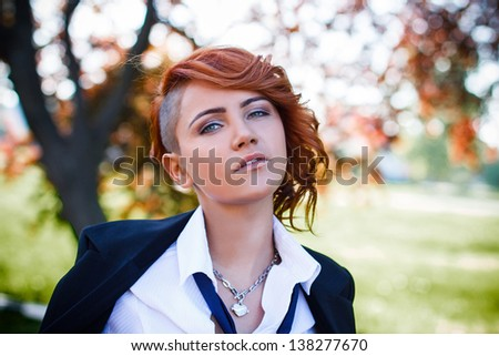 Redhead student portrait at outdoor - stock photo