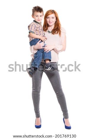 Redhead woman posing with a little boy on her hands. Isolated - stock photo