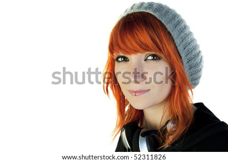 Redhead young woman with a cap and headphones - stock photo