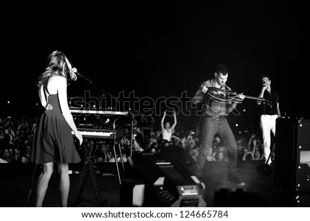 REDMOND, WA  - AUGUST 25, 2012:  Indie rock band FUN performs on stage for the End Summer Camp at Marymoor Amphitheater in Redmond, WA on August 25,2012. - stock photo