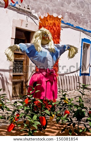 REDONDO, PORTUGAL - AUGUST 10: Festival flower  in streets in Alentejo- Ruas floridas-Made paper dolls on August 10, 2013 in Redondo, Portugal