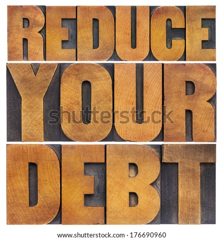 reduce your debt - financial concept - isolated text in vintage letterpress wood type - stock photo