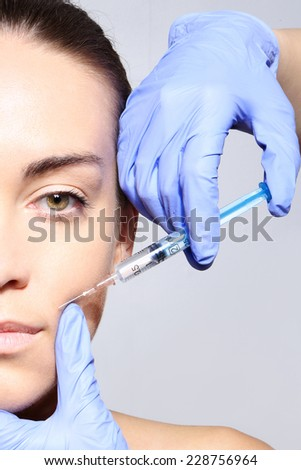 Reduction of wrinkles, injection, nasal labial folds .Portrait of a white woman during surgery filling facial wrinkles  - stock photo