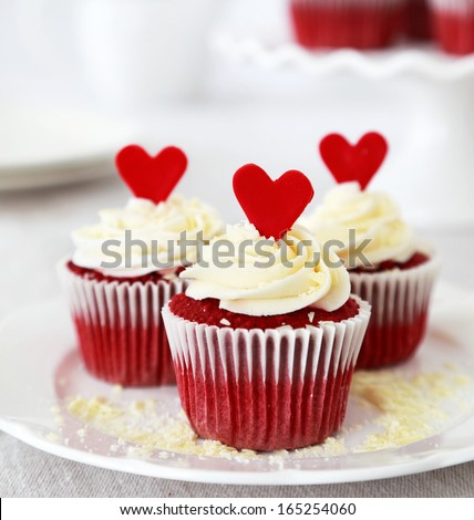 Redvelvet cupcakes with cream cheese frosting and a red heart - stock photo