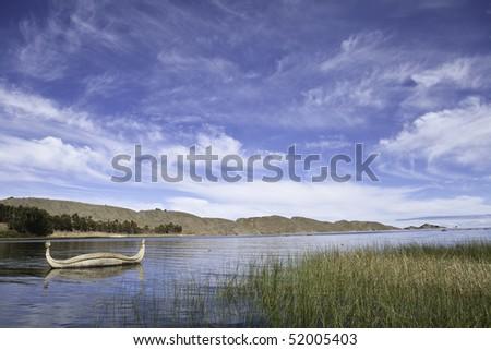 reed boat at lake titicaca bolivia andes landscape peru bolivia border - stock photo